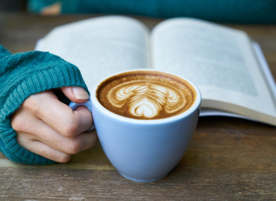 Reading a book and cup of coffee