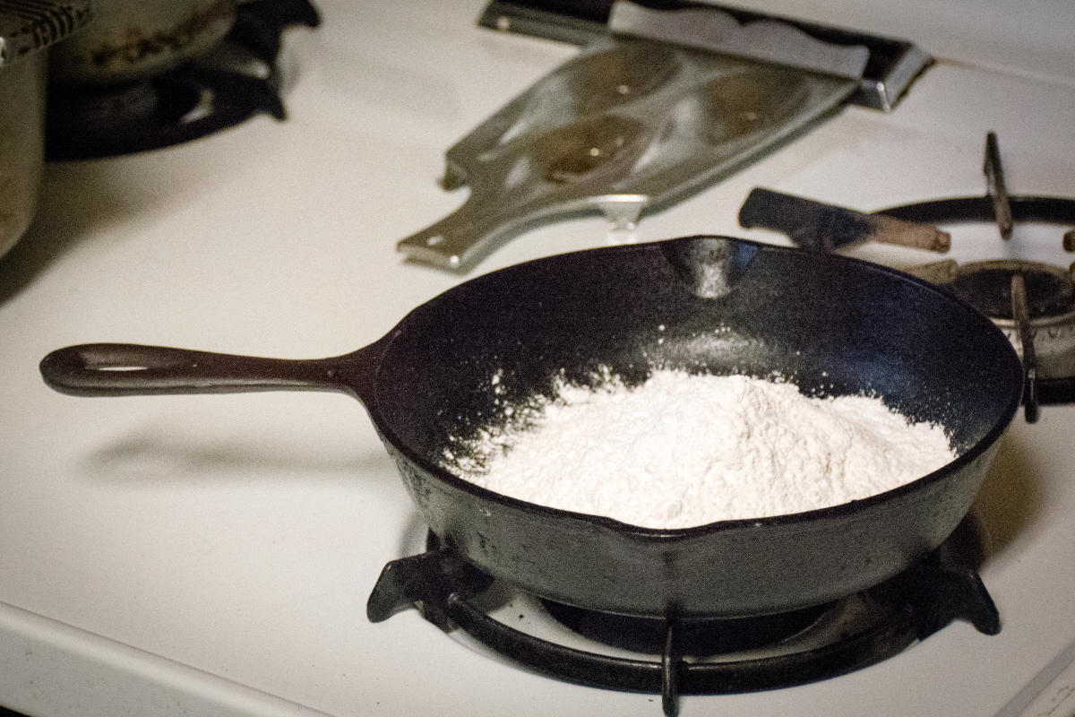 Flour in Cast Iron on Stove Top