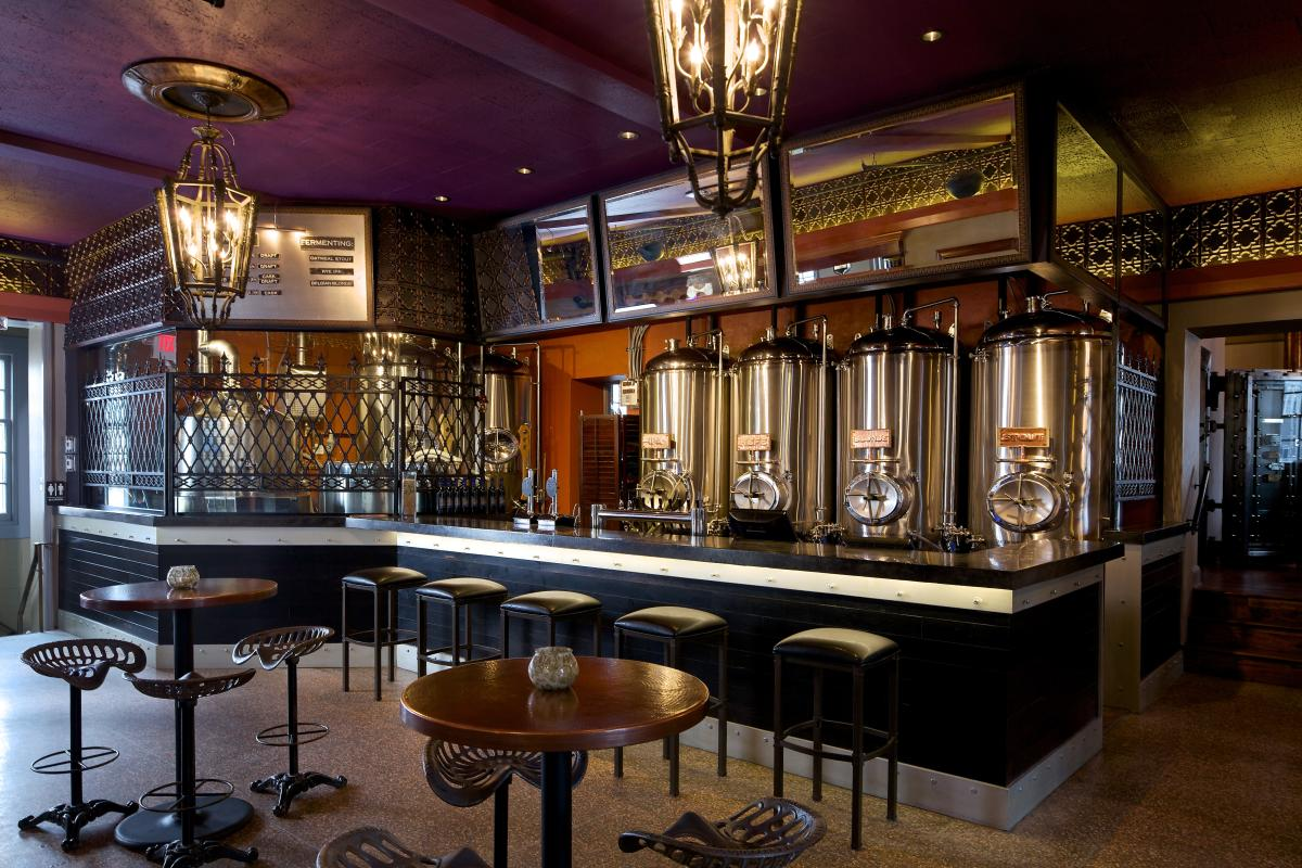 The original bank vault is now the brewing company's beer-conditioning cellar. Pair one of the speakeasy-like brewpub's five to six beers on tap each day with Pad Thai popcorn, duck and apple pizza or wood-fired s'mores.