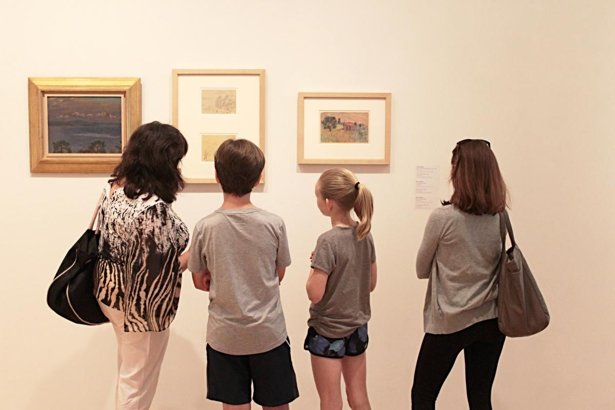 Family admire artwork at the Hillard University Art Museum in Lafayette, LA
