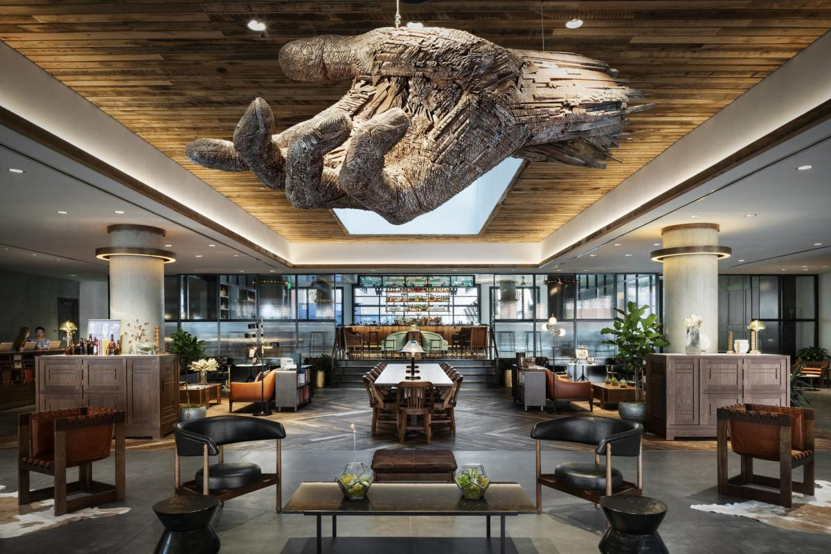 Carved wooden hand sculpture at The Maven hotel