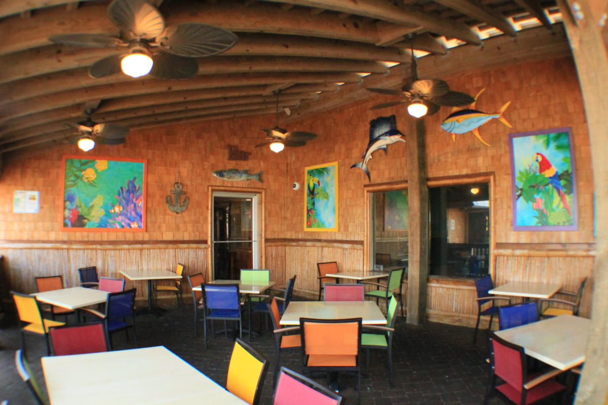 Tables and colorful chairs in Jack Mackerel's Island Grill