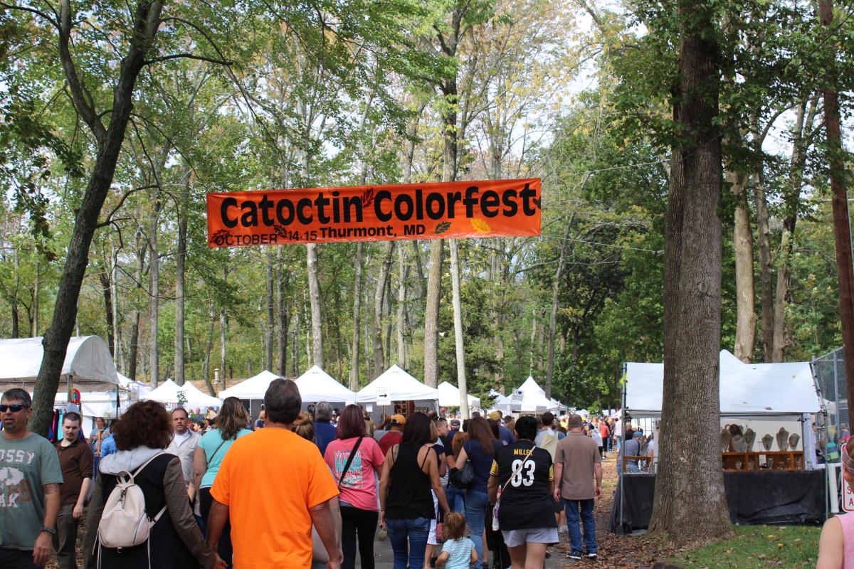 Crowd walking into the the Catoctin Colorfest below the banner