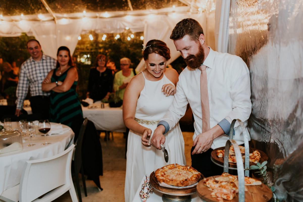 "Bride and Groom cutting their ""Pizza Cake"""
