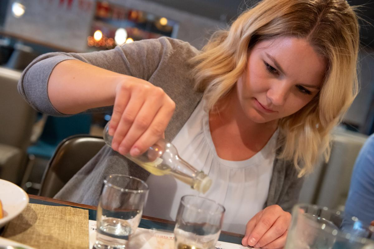 Woman concocting her own bitters