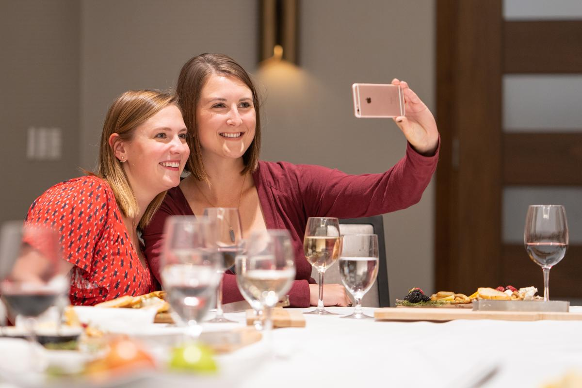 Two women take a selfie during the Build a Wisconsin Cheese Board experience in Madison, WI