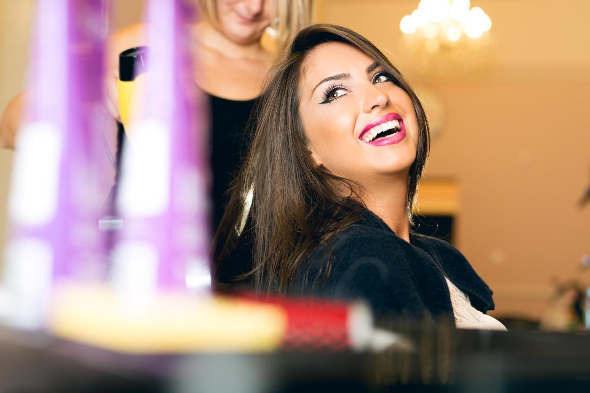 Woman Laughing at Salon - iStock