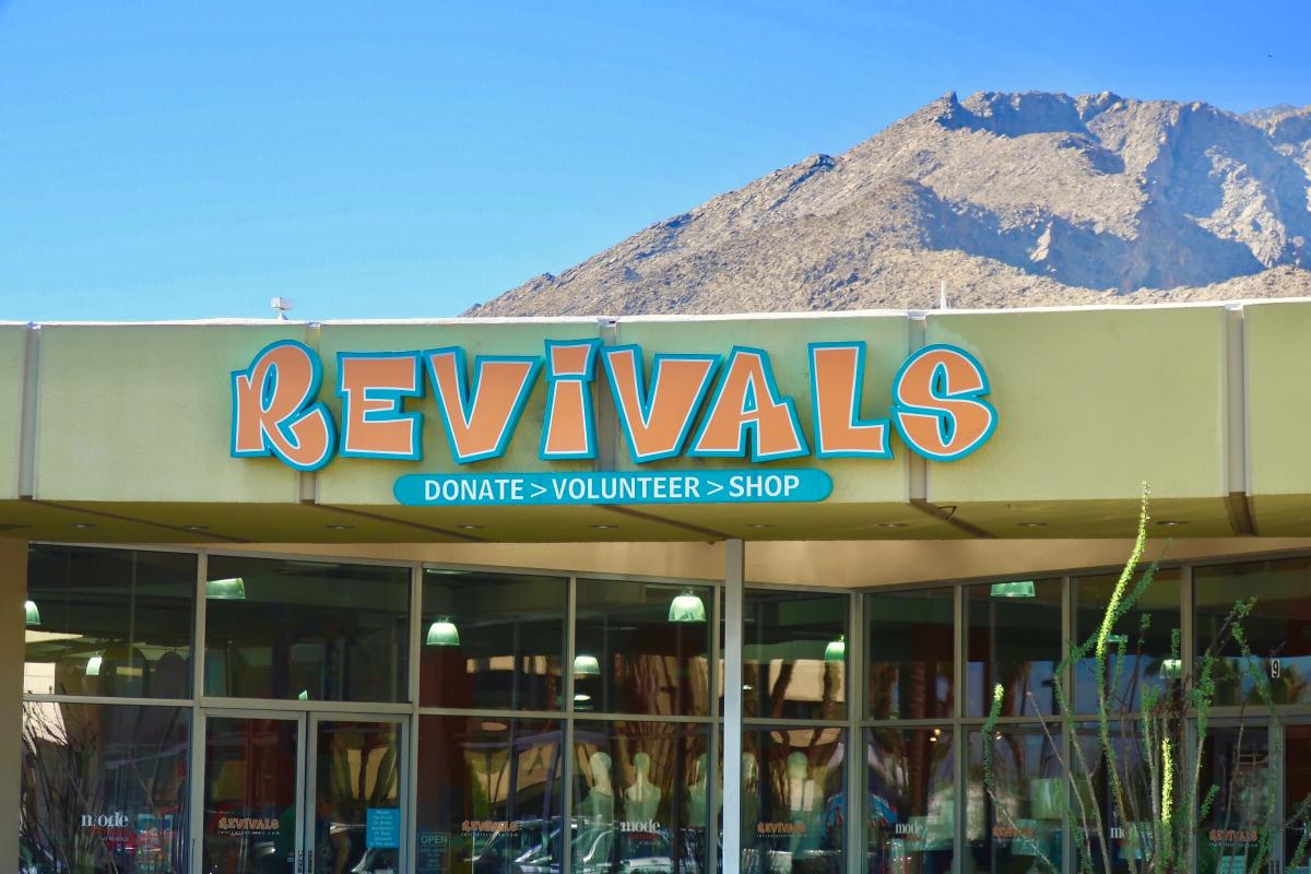 Store front Revivals with clear blue sky and rocky mountains behind the store.
