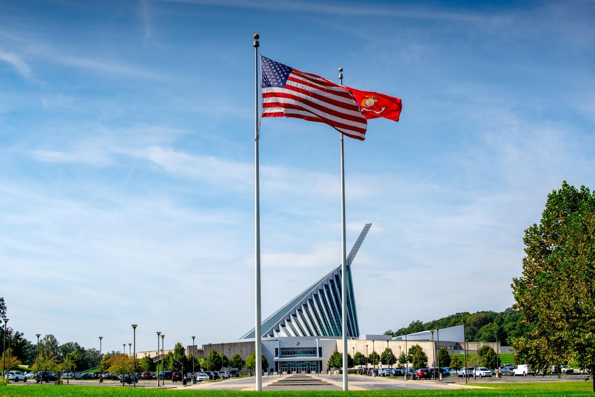 view of the outside of the national museum of the marine corps with flags in foreground