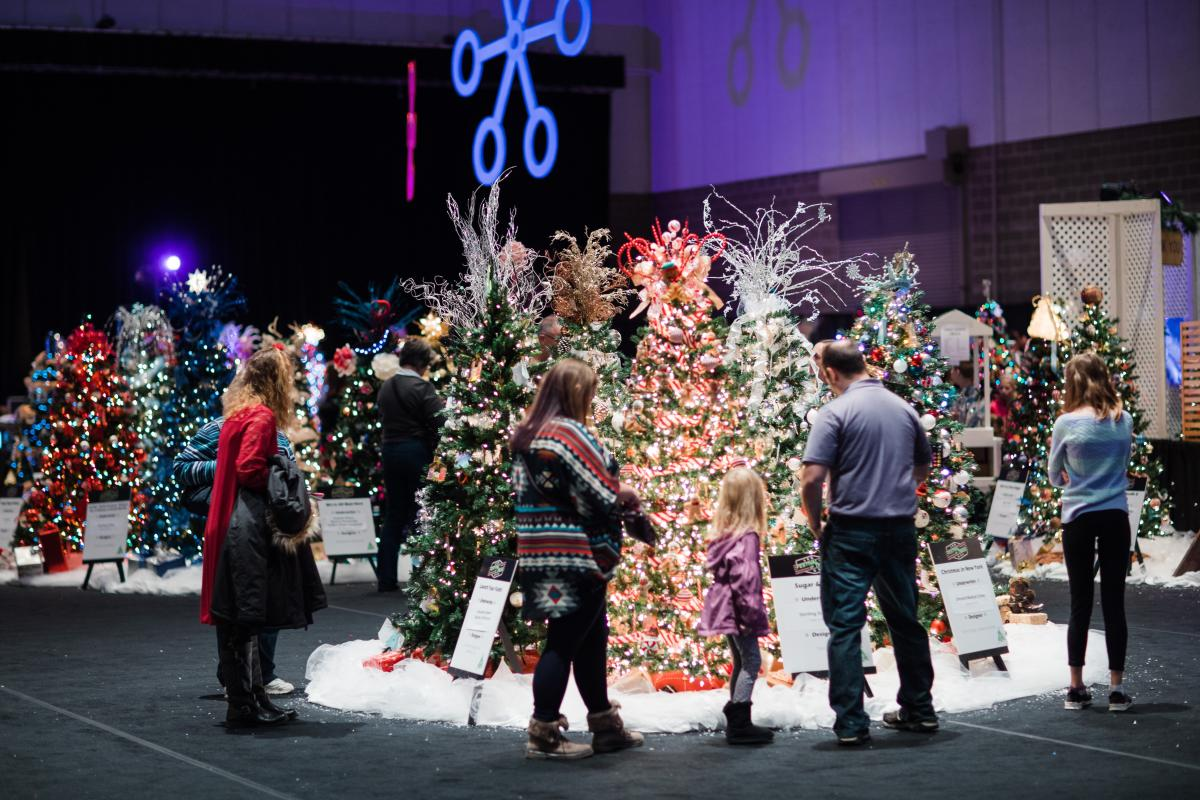 People viewing  trees at Festival of Trees in Rochester, MN