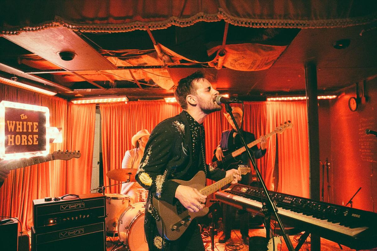 Robert Ellis and band playing live music at the White Horse during Hot Luck Live Food & Music Festival in Austin Texas