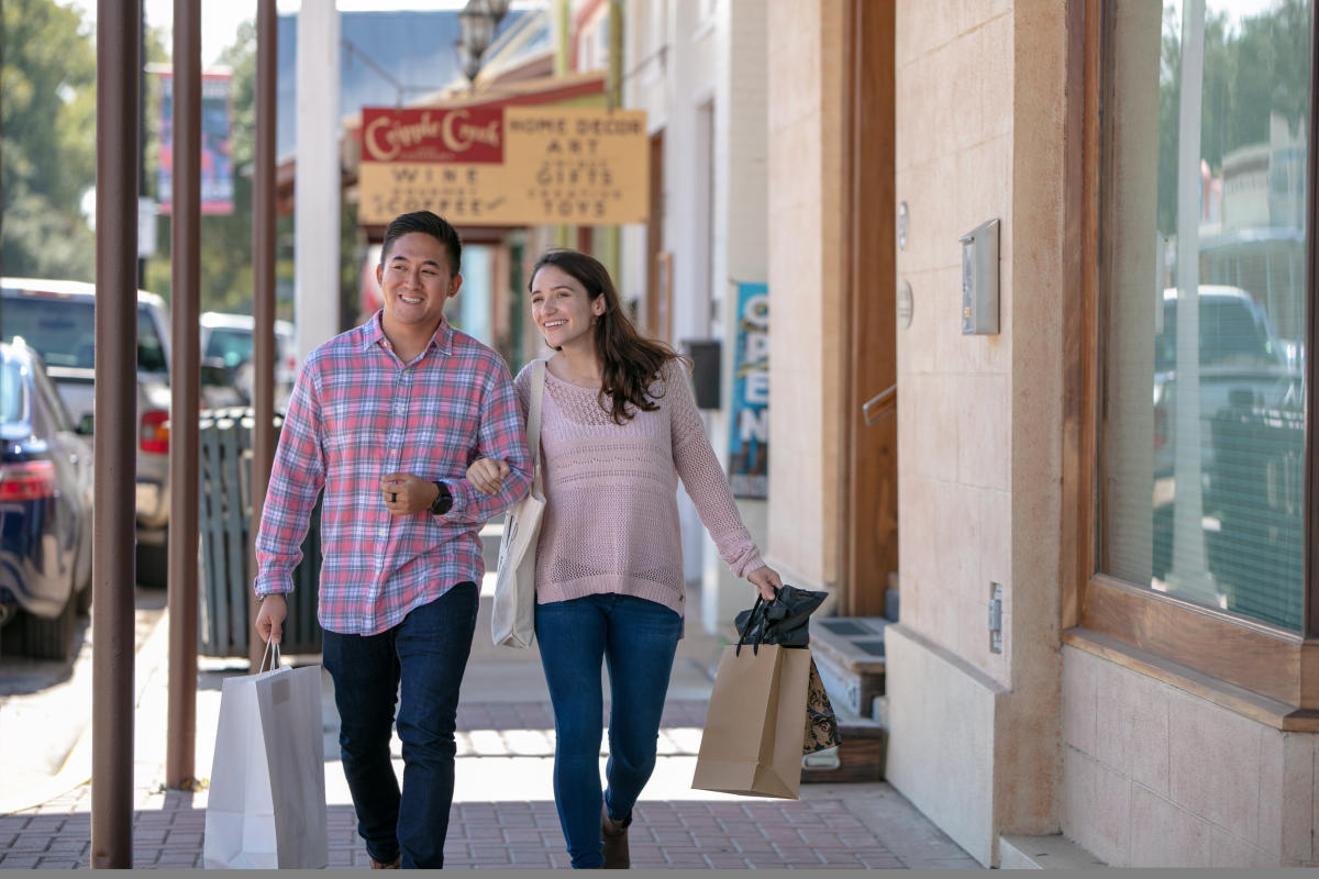 Couple Walking Downtown Bastrop Shopping