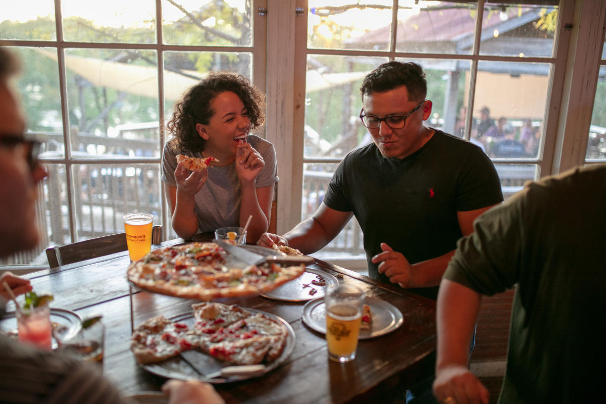 Couple Enjoying Pizza & Beer