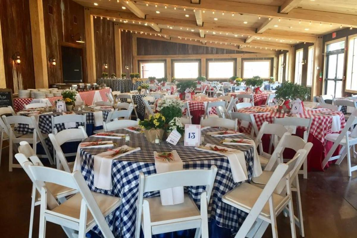 Amelia Farm and Market Eating Area With Round Tables And Checkered Table Cloths