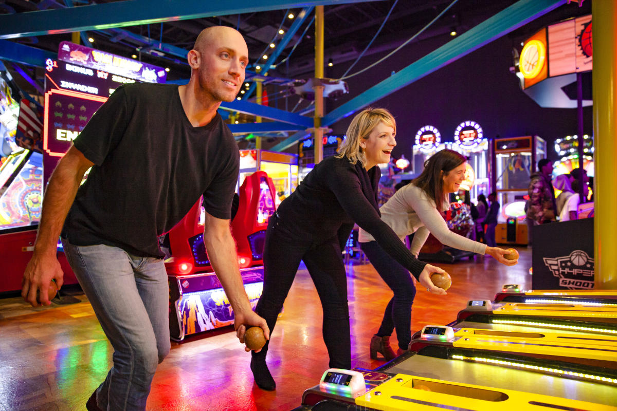 Families playing games at Main Event Entertainment in DuPage