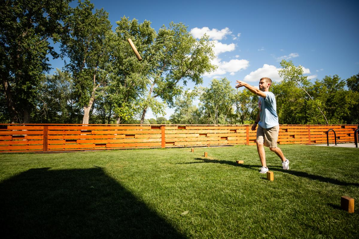 Guy playing Kubb at the Brewing Projekt
