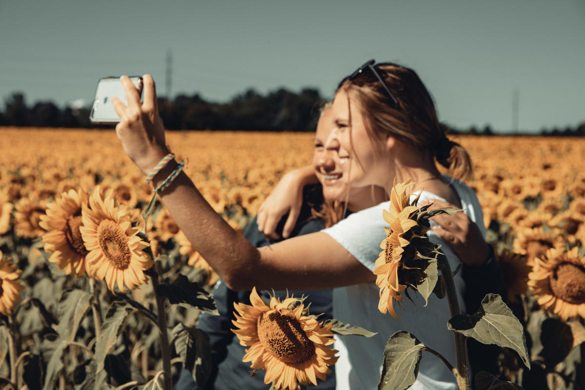 Taking selfies in a field of sunflowers at Babbette's Seeds of Hope