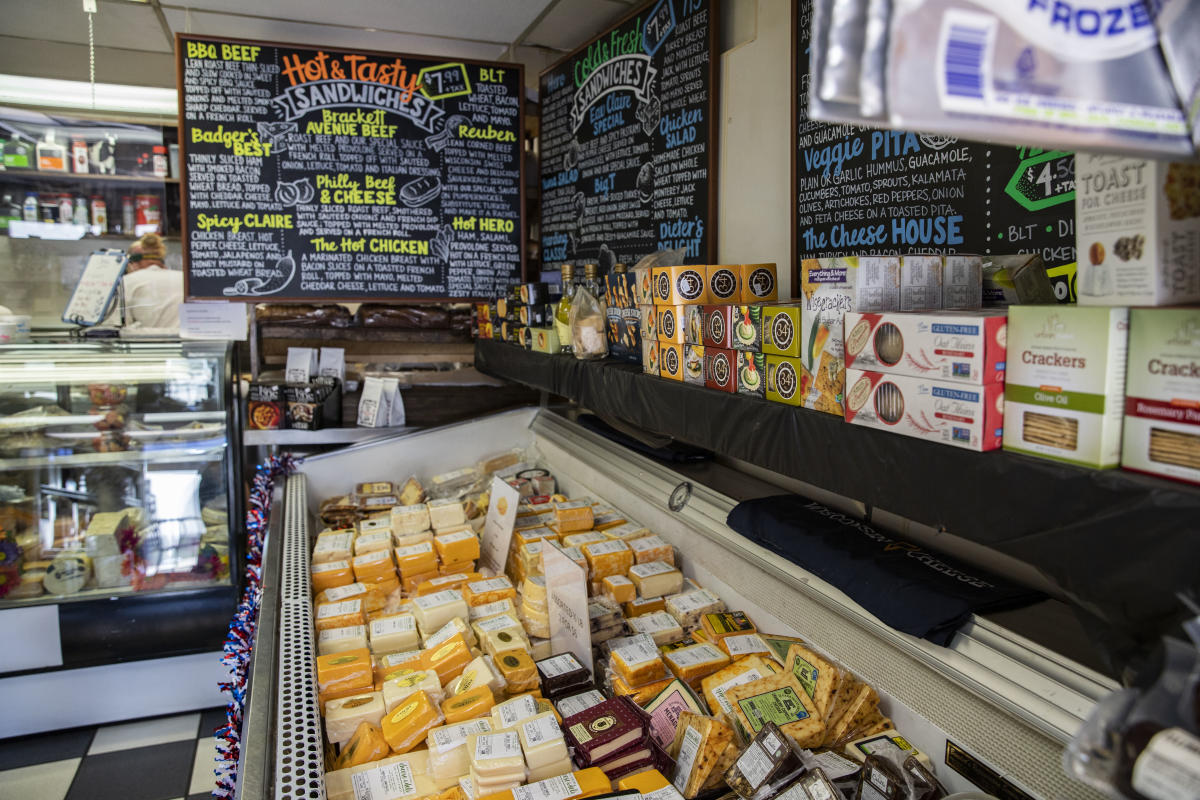 Cheese and other foods for sale at Eau Claire Cheese and Deli