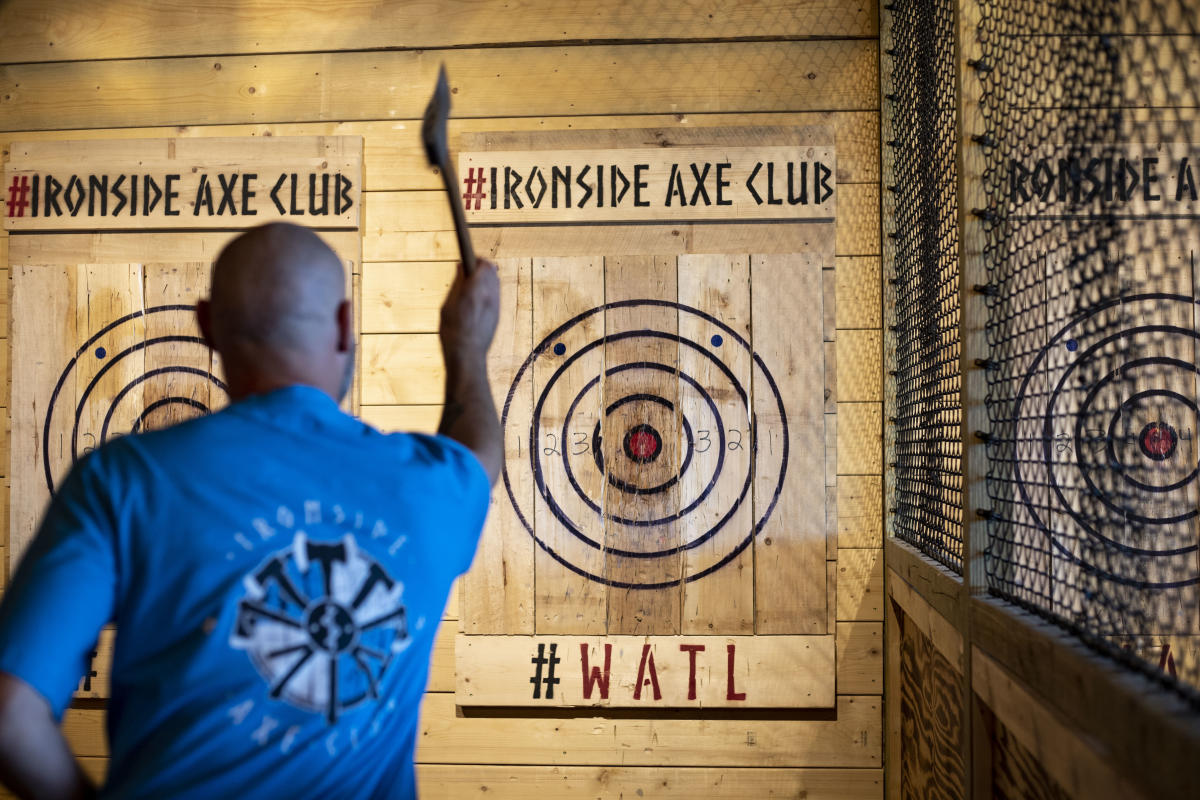 Man throwing axe at Ironside Axe Club