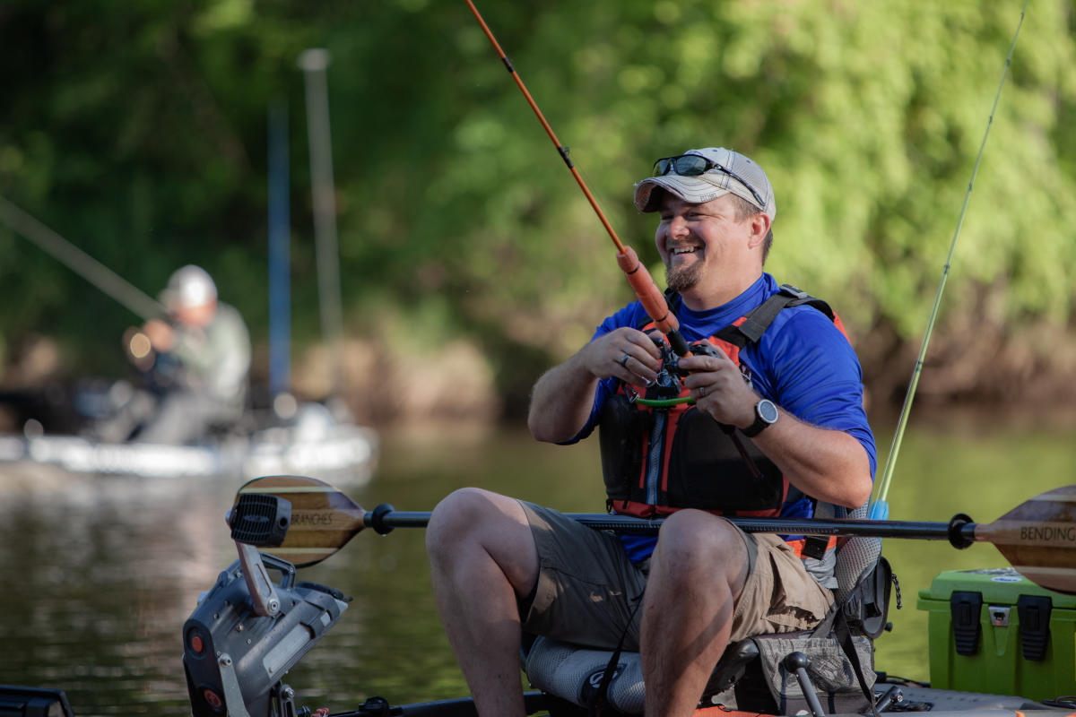 Man in a kayak bass fishing in a Wisconsin river