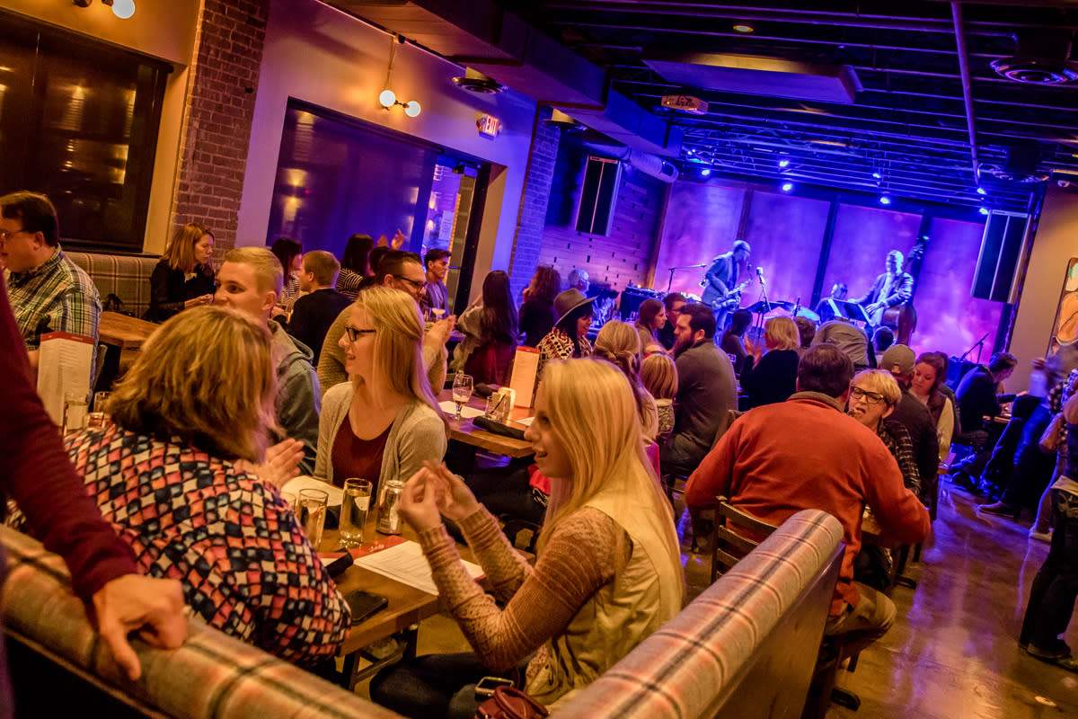 People listening to live music at the Lakely in downtown Eau Claire