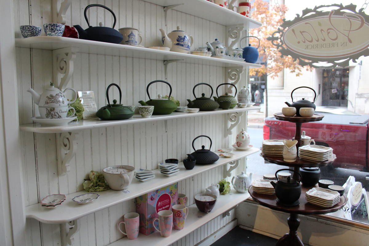 Tea kettles, pots, saucers and cups at Voila