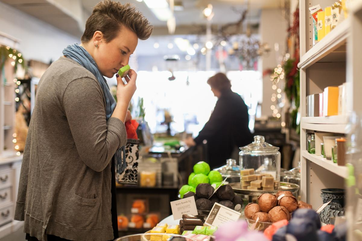 Woman smelling soap in a Frederick boutique