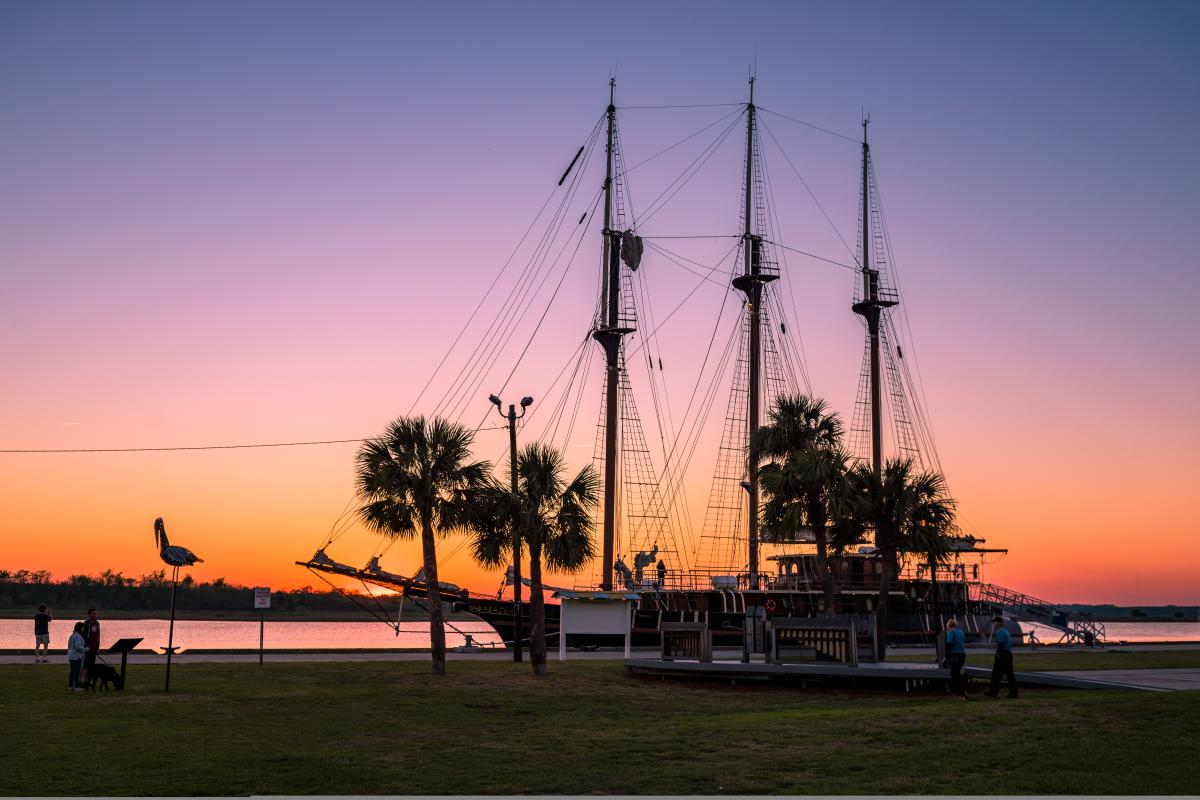 Sunset behind boat at Mary Ross Waterfront Park in Historic Downtown Brunswick, Georgia