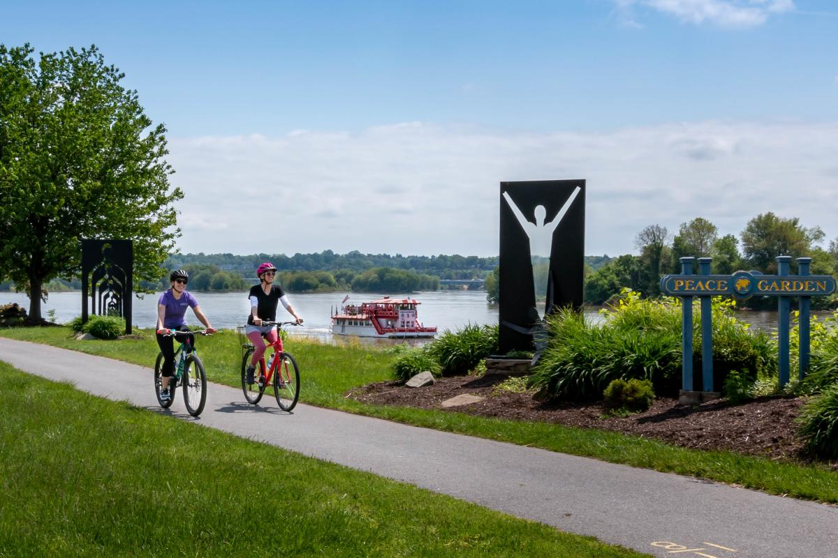 Biking Riverfront Park w Riverboat Background