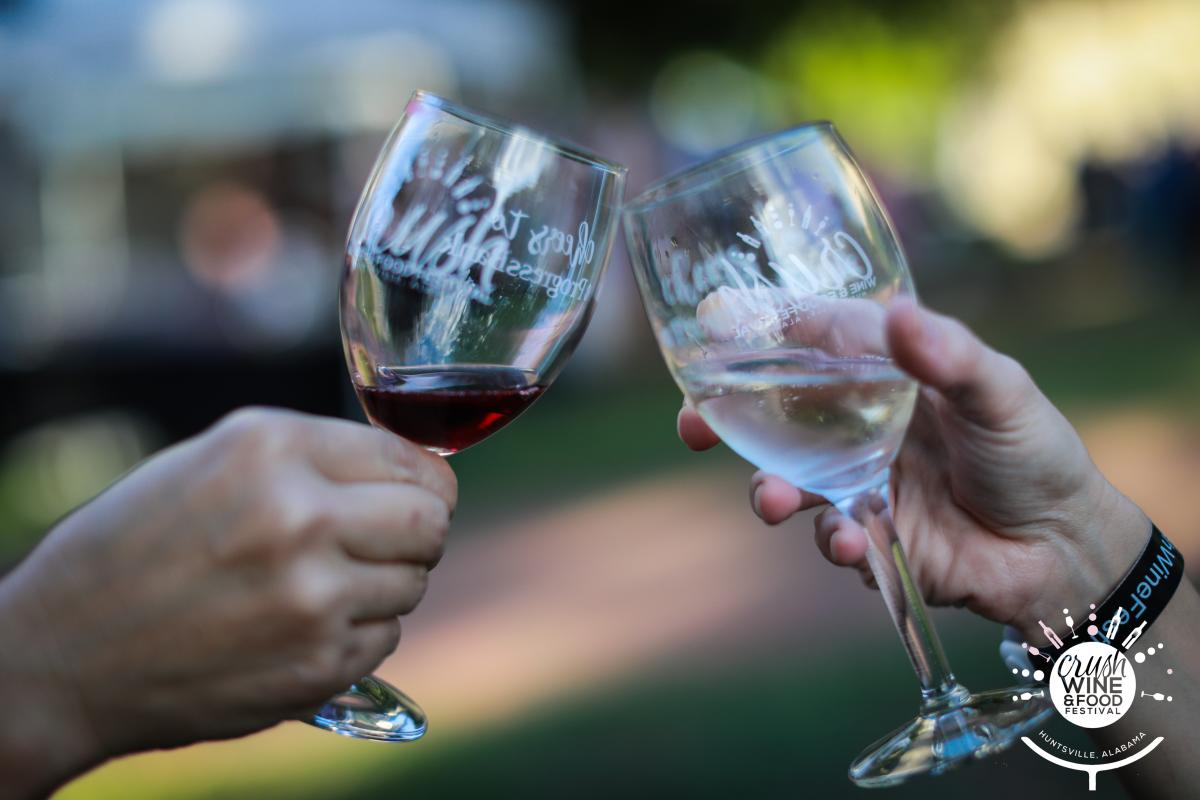 Wine Glasses toasting at Huntsville Crush Wine and Food Festival