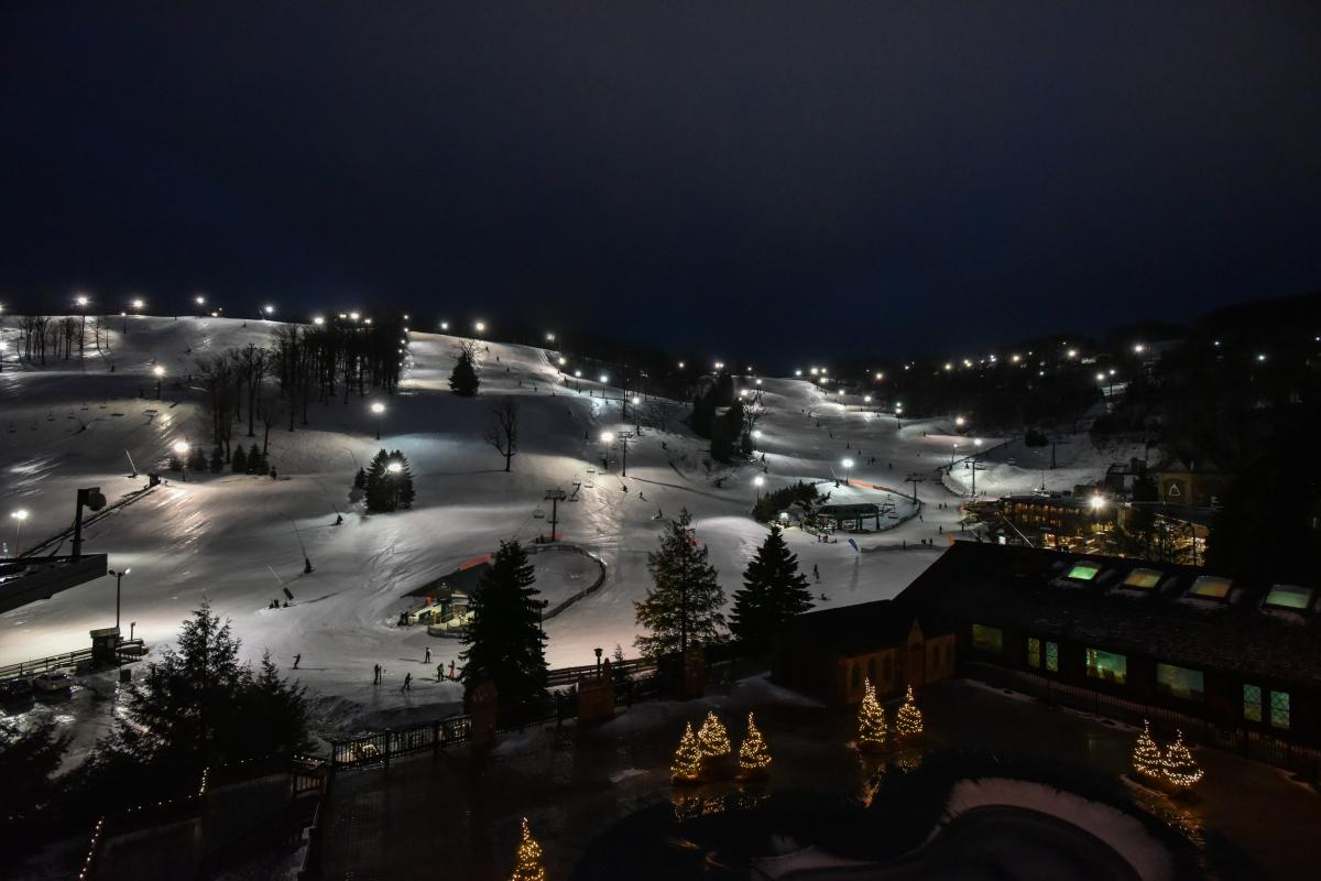 Aerial shot of Seven Springs Resort on a winter night