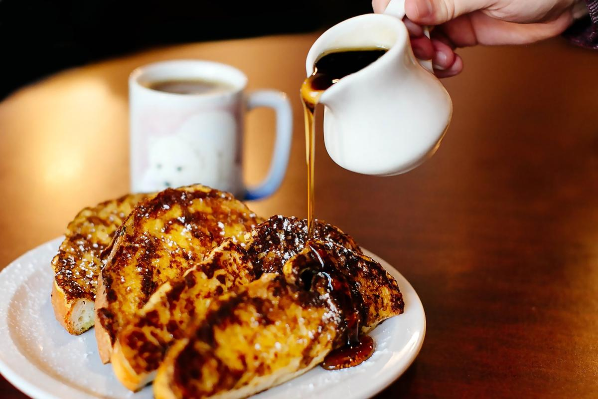 French toast drizzled with syrup from Alfalfa.