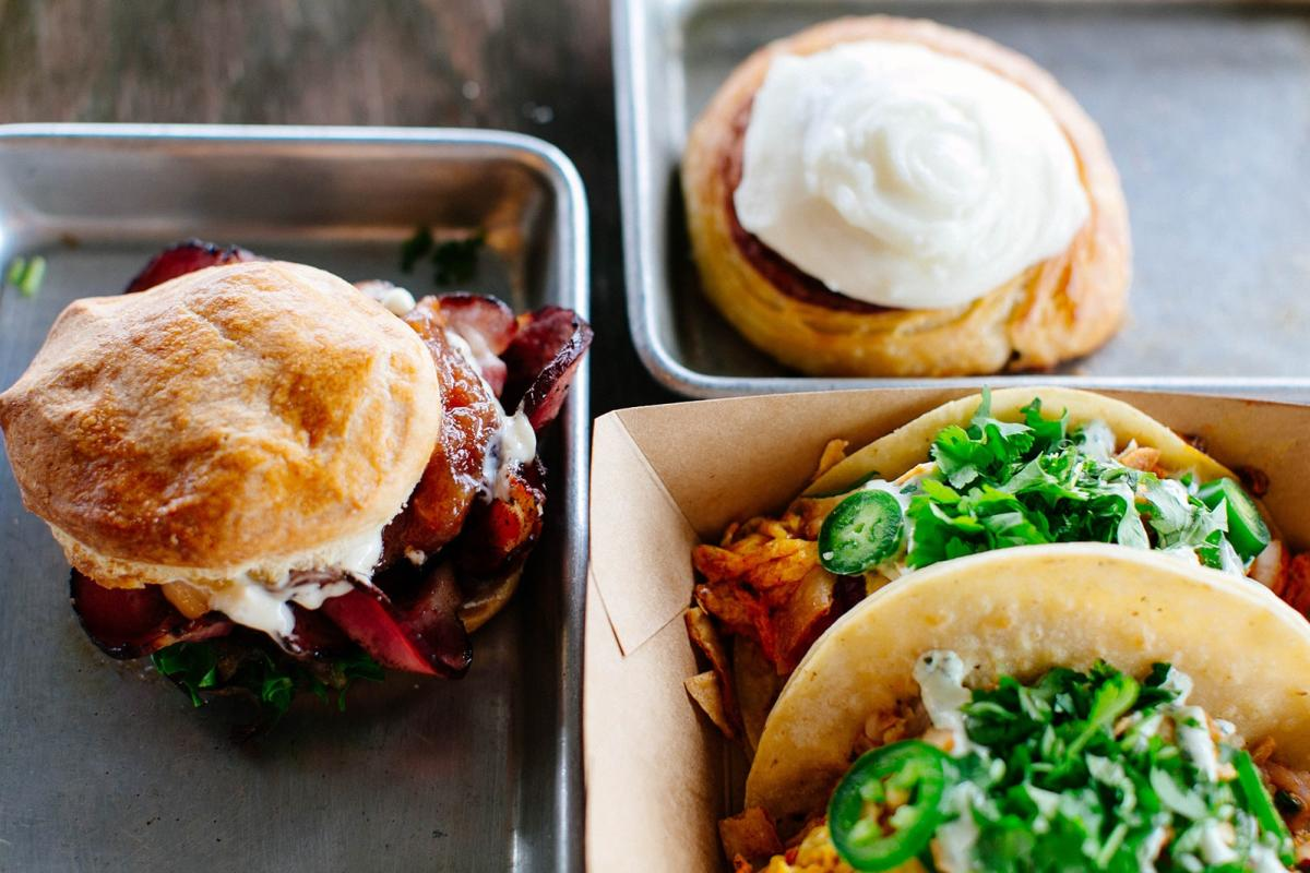 A monster egg sandwich, hand-rolled cinnamon roll and tasty breakfast tacos at DV8 Kitchen.