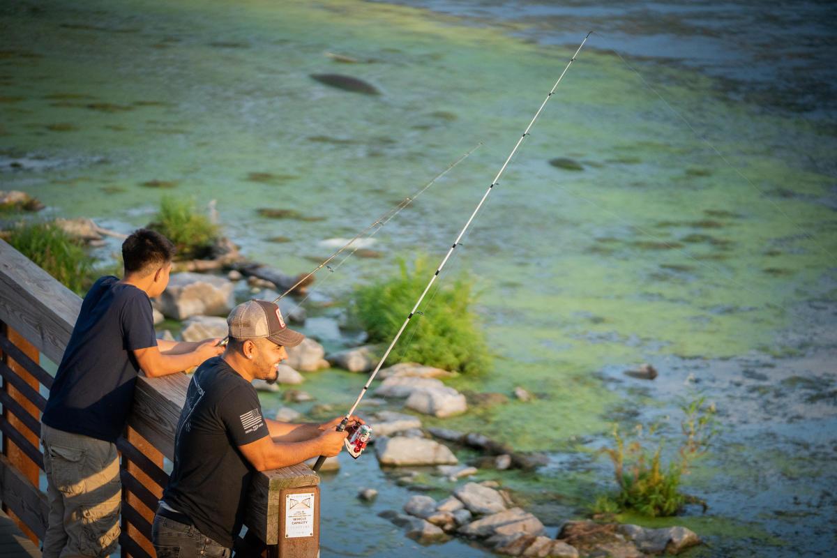 Two men fishing on Lake Waubesa