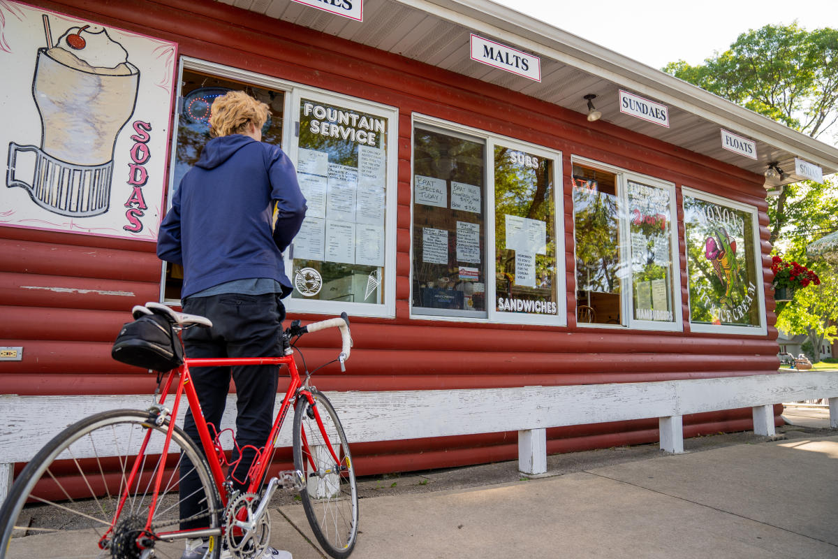 Bicyclist outside of Monona Bait and Ice Cream