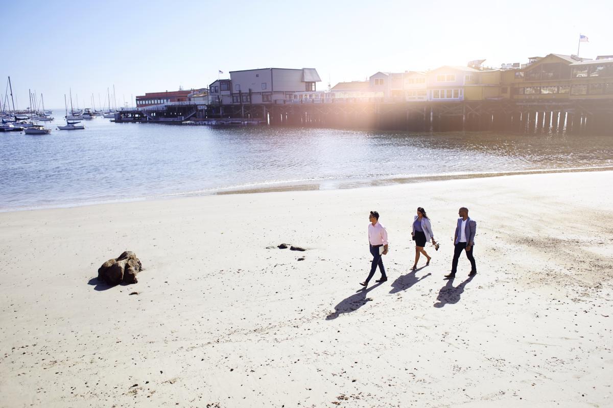 Walking on the beach near Monterey Wharf
