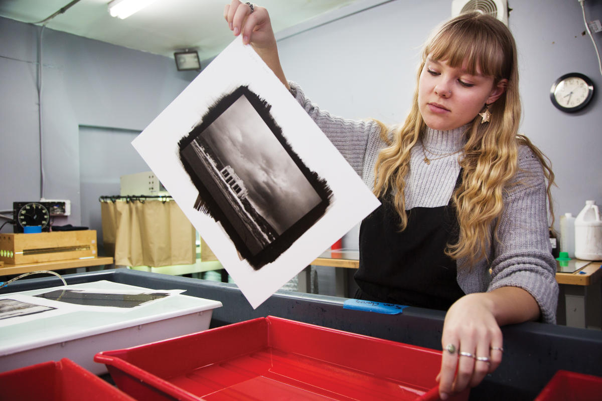 Chiara Brandi moves a print from the cleaning tray to the water bath.