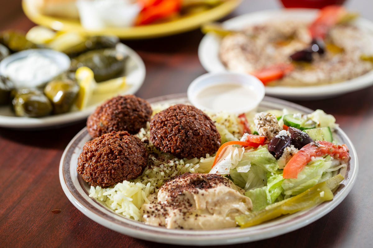 Falafel served with hummus, saffron rice, a Greek salad, and tahini sauce at Cafe Istanbul.