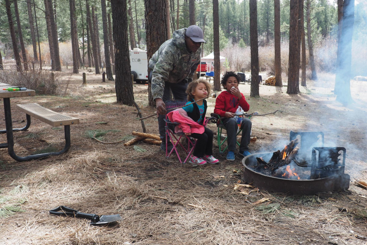A family from Rio Rancho roasts marshmallows at their Fenton Lake campsite.