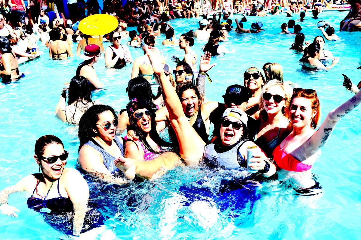 Women in pool celebrating at The Dinah.