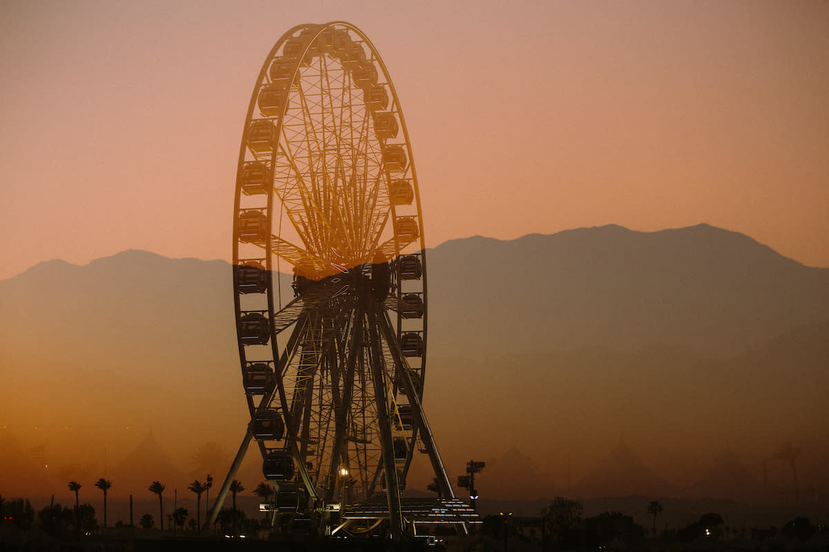 Ferris wheel and desert mountains.