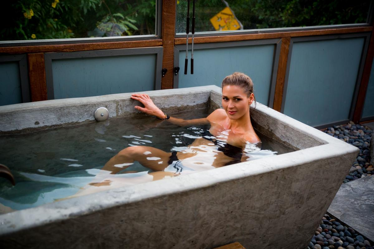 Woman relaxing in private mineral soaking tub at the Spring Resort and Spa in Desert Hot Springs, California