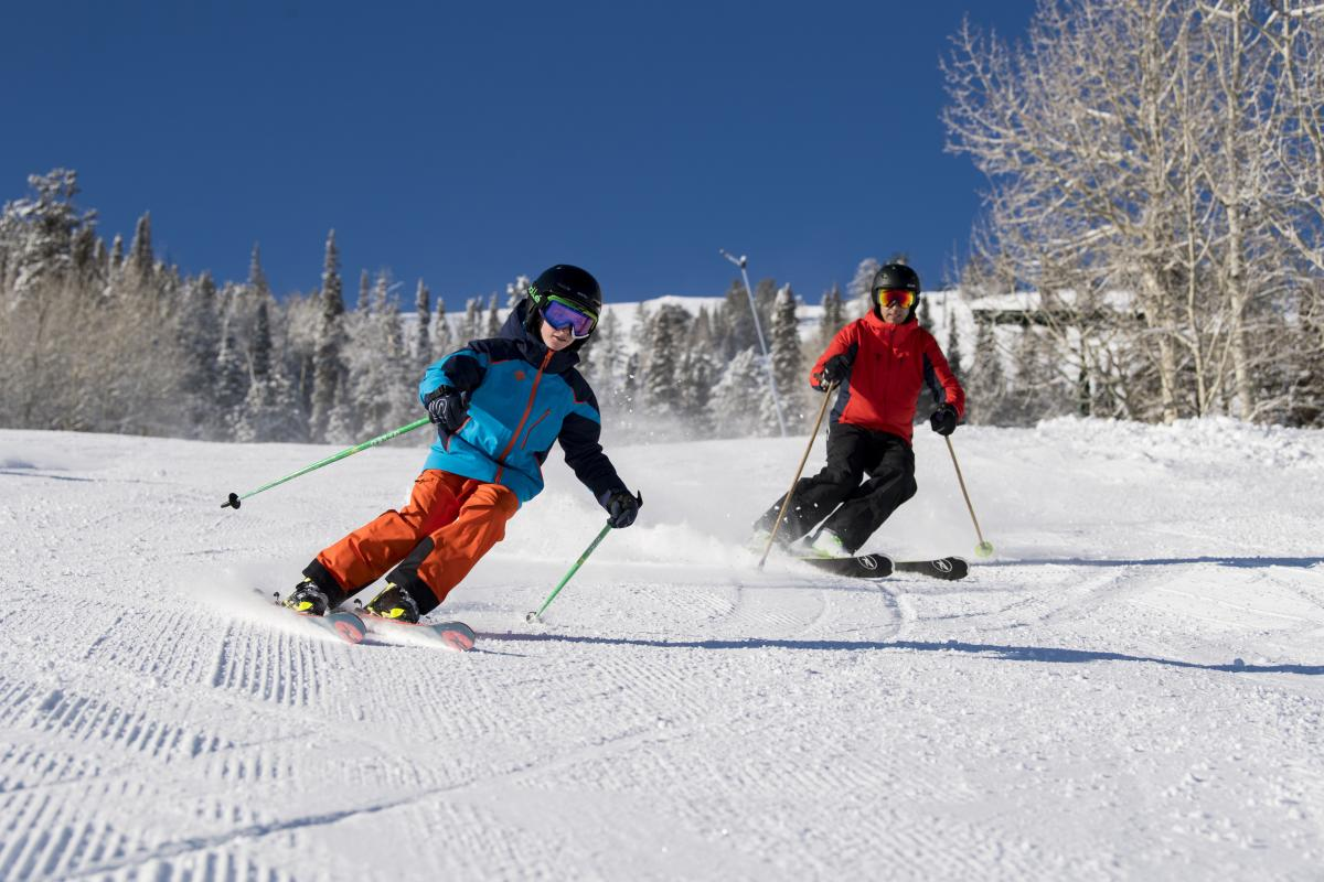 Family skiing on sunny day at Deer Valley Resort