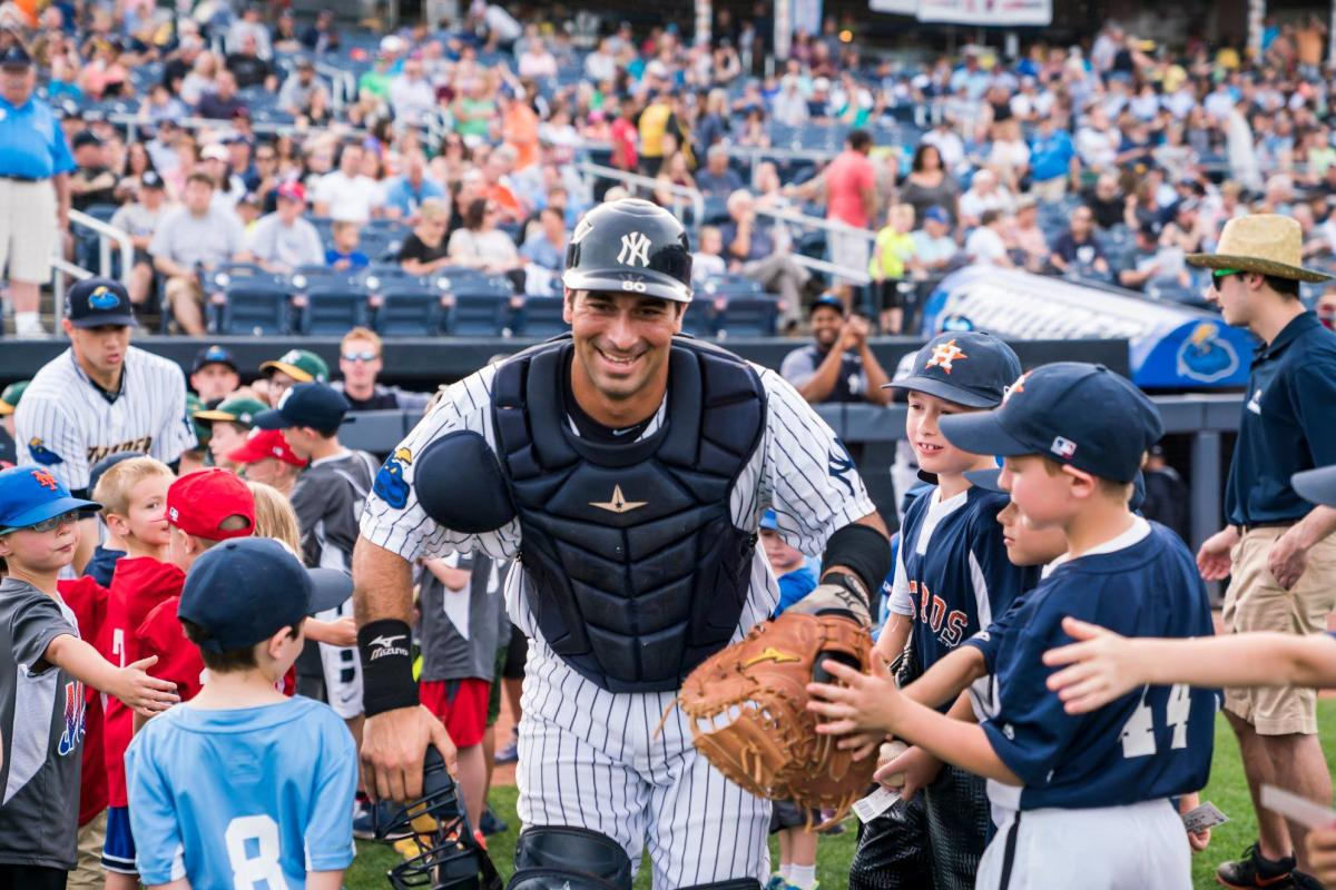 Trenton Thunder catcher giving kids high fives at opening night