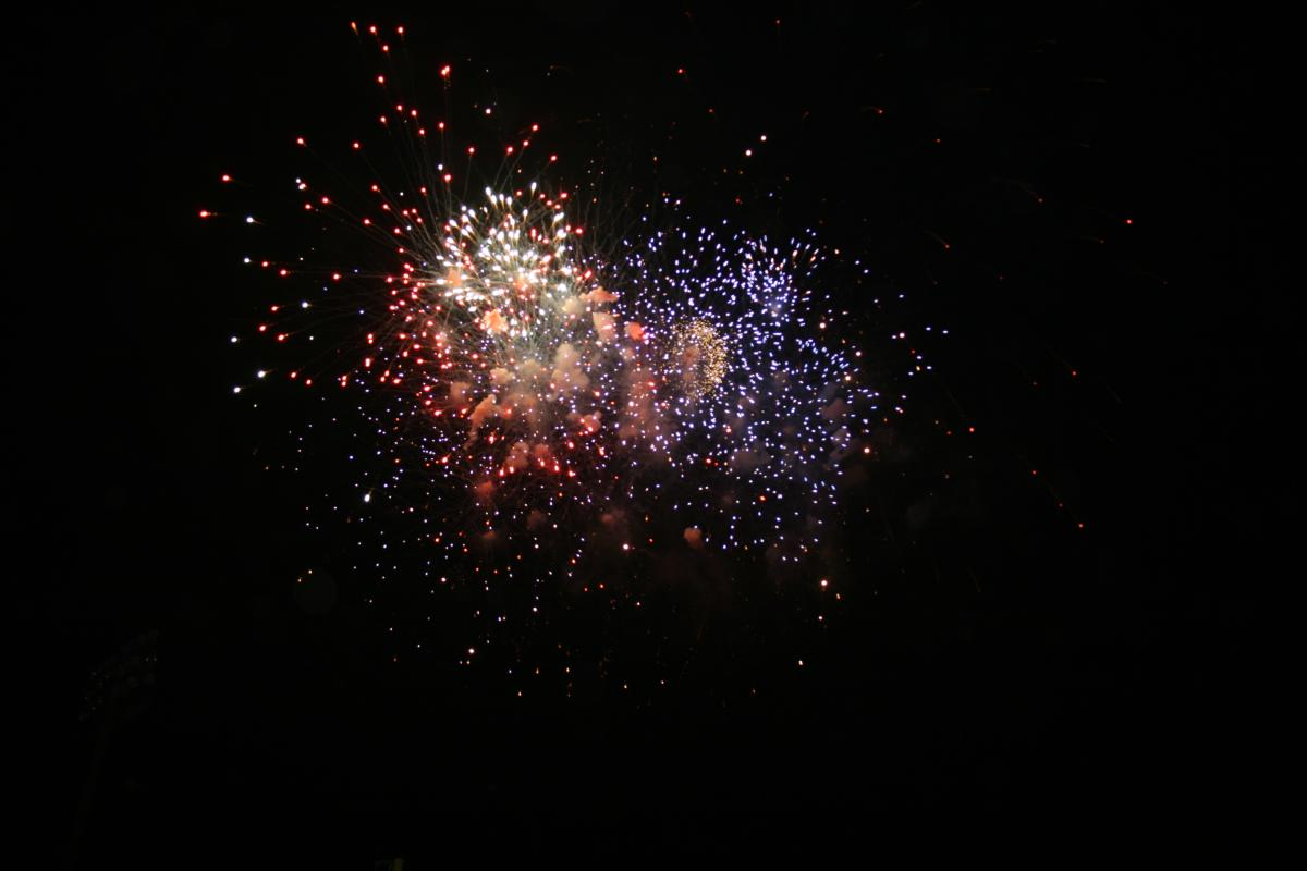 dark sky with red and purple fireworks