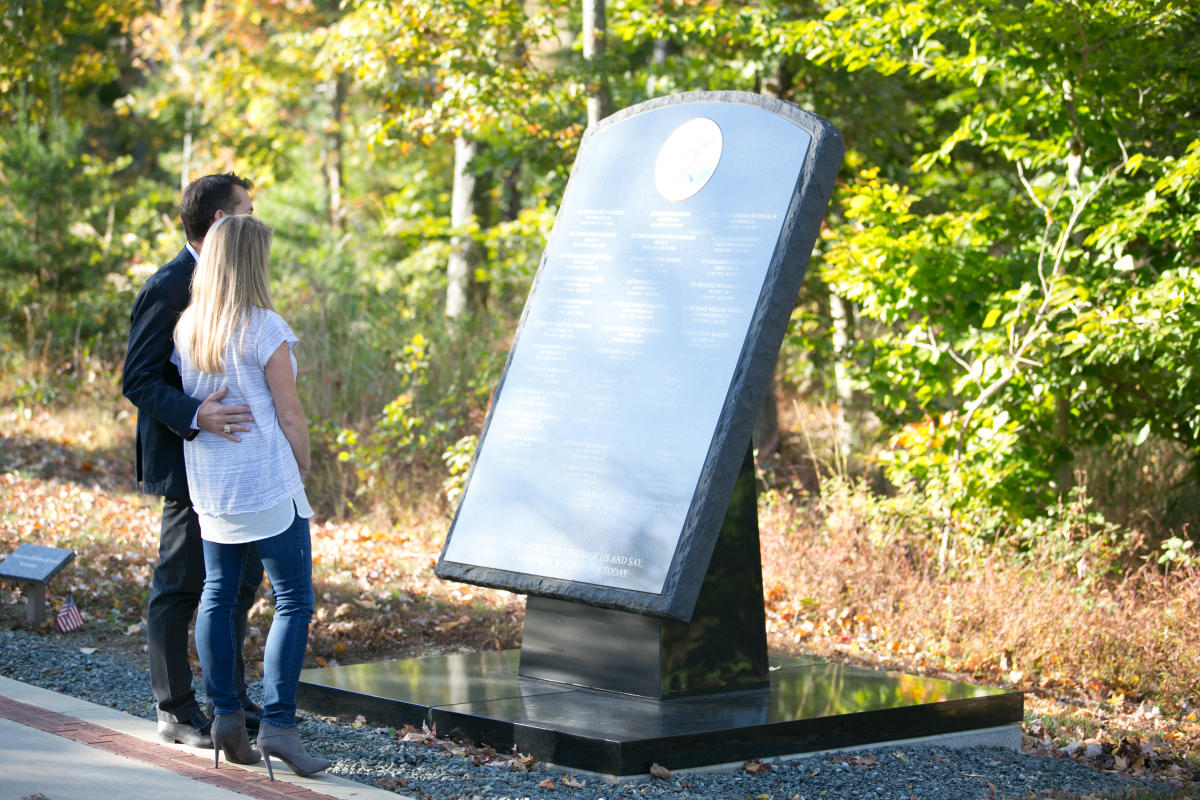 couple looking at an outdoor plaque at the  National Museum of the Marine Corps