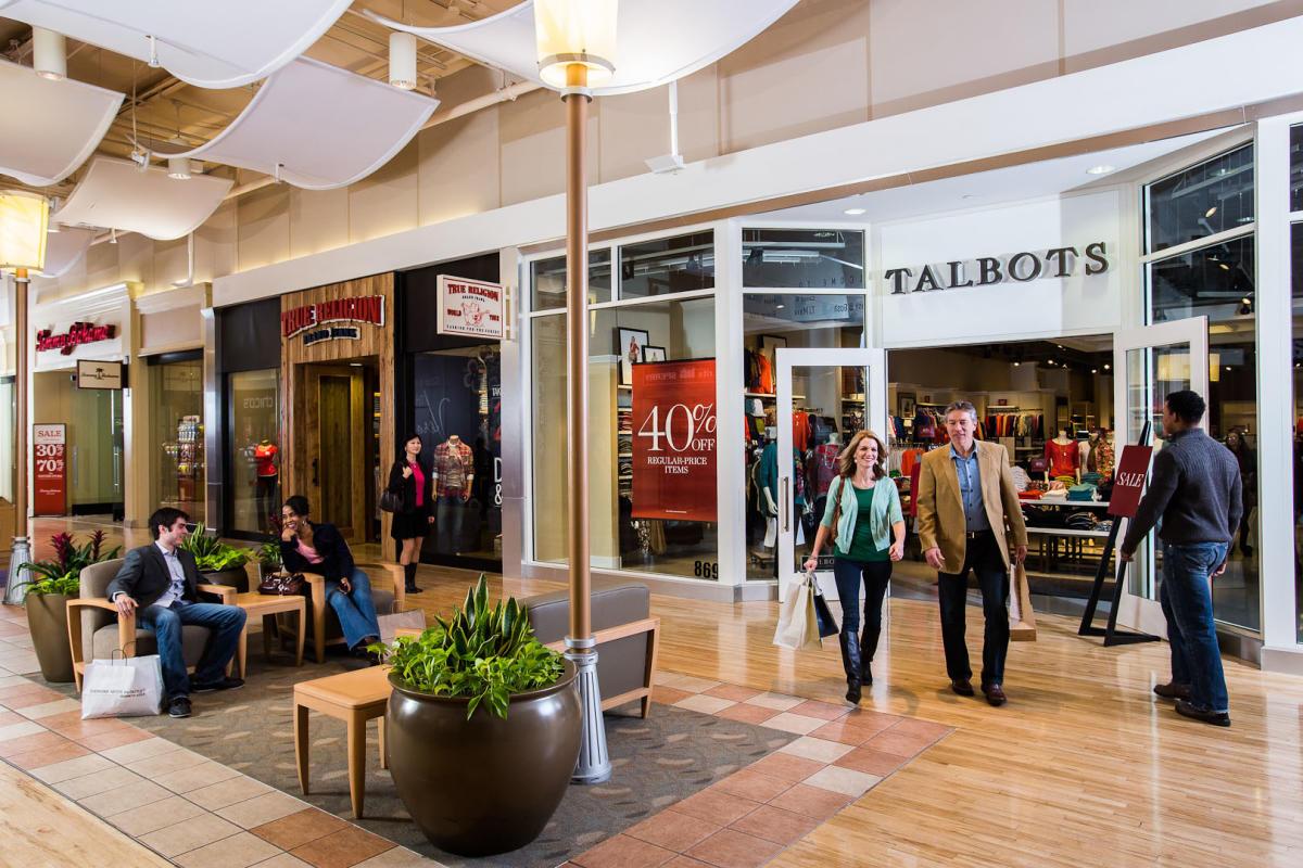 a variety of people shopping at Potomac Mills