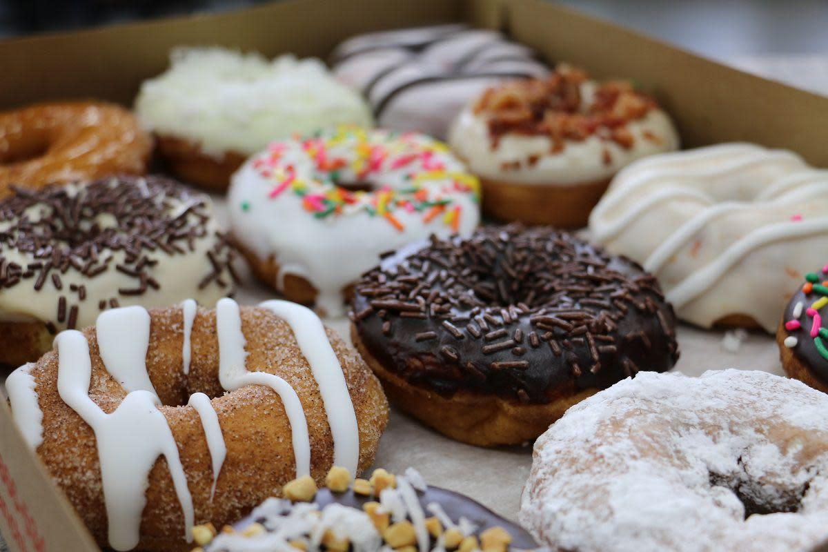 variety box of flavored donuts
