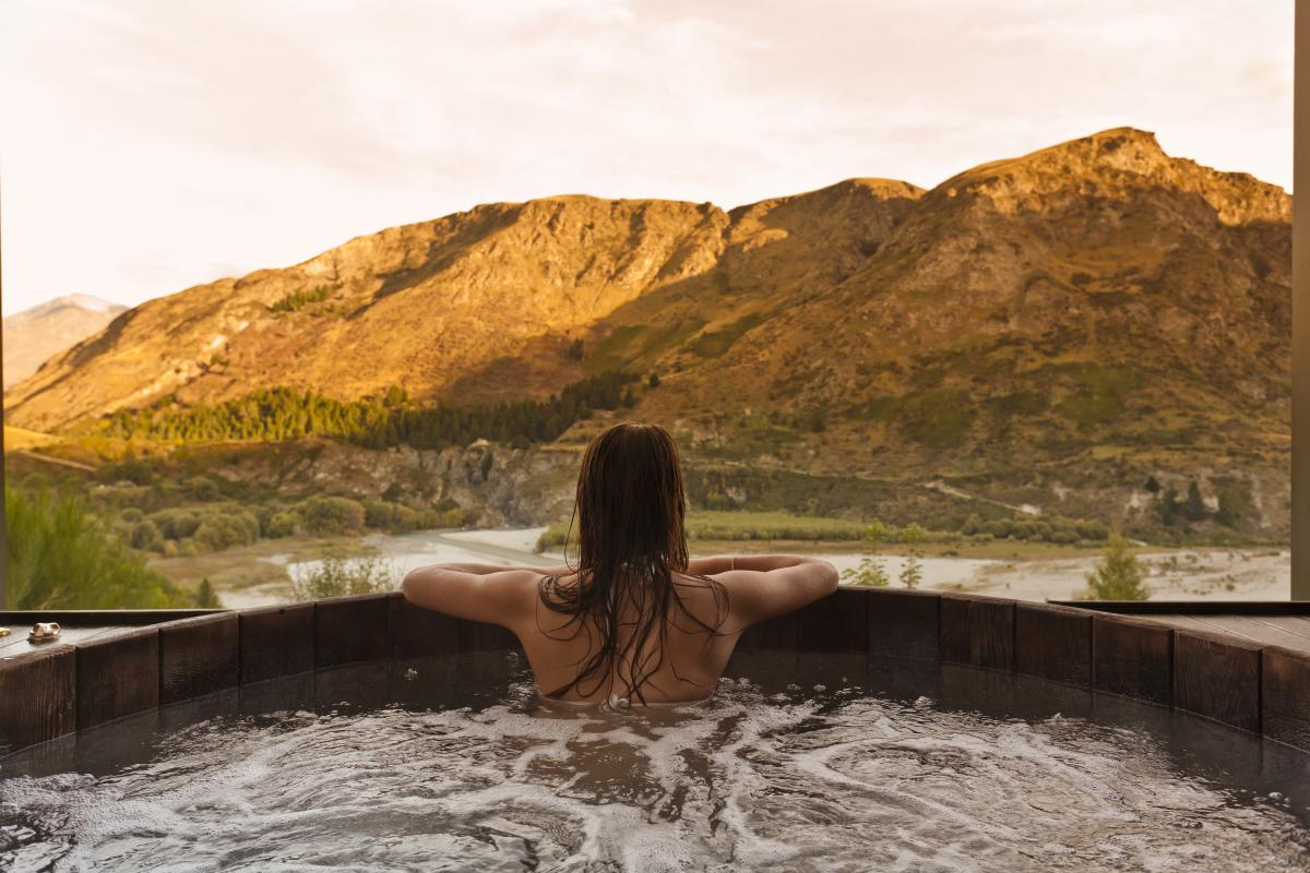 Woman relaxing at Onsen Hot Pools, Queenstown