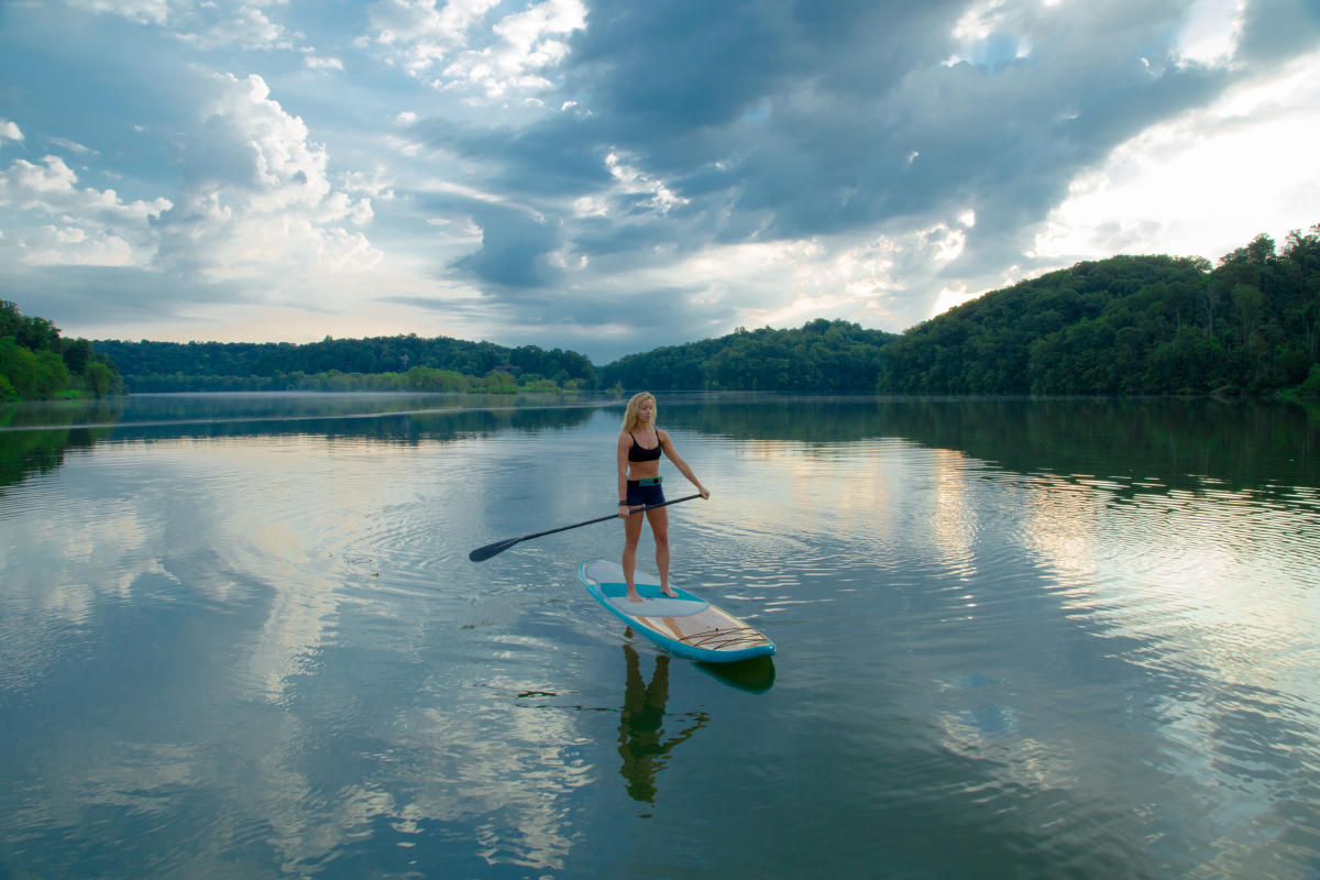 A woman paddle boarding at Morgan Falls in Sandy Springs